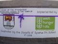 Eine violette Schleife für den Wassertank